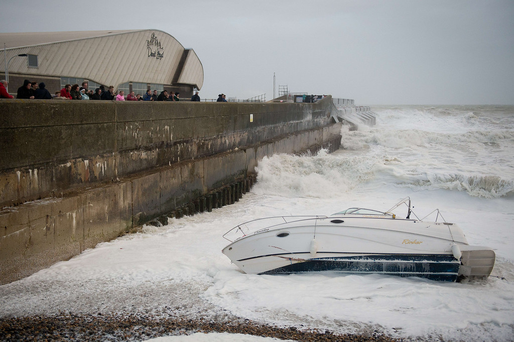 . A boat is dragged from its mooring on the beach and destroyed by large waves near Brighton Marina, in southern England on October 27, 2013 ahead of a predicted storm. Britain was braced on October 27 for its worst storm in a decade, with heavy rain and winds of more than 80 miles (130 kilometres) an hour set to batter the south of the country.   LEON NEAL/AFP/Getty Images