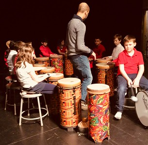 Grade 3 drumming with parent Eric Brenneman