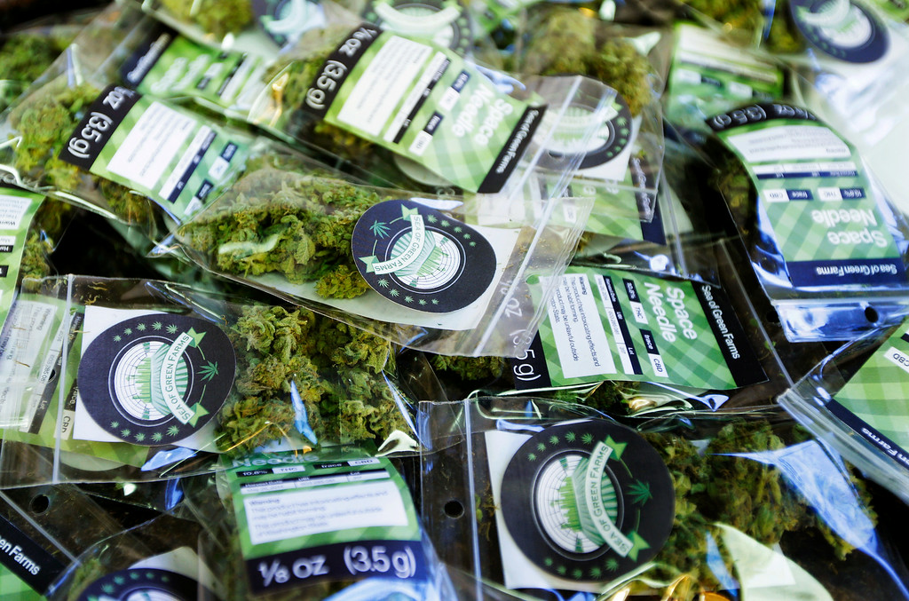 ". In this photo taken Tuesday, July 1, 2014, packets of a variety of recreational marijuana named ""Space Needle\"" are shown during packaging operations at Sea of Green Farms in Seattle. The grower, the first business licensed to grow recreational marijuana in Washington state, worked all weekend to have supplies ready for stores that were expected to be granted sale licenses on Monday, July 7, the day before legal recreational pot sales begin on July 8. (AP Photo/Ted S. Warren)"