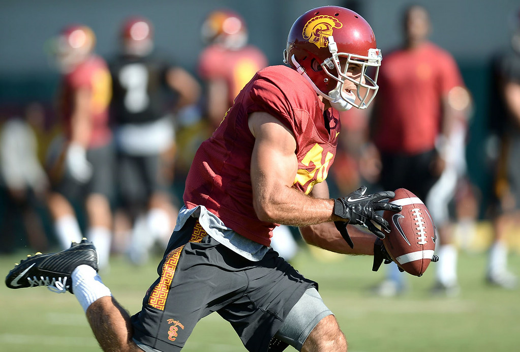 . Christian Tober tries to catch a pass during practice August 27, 2014 on USC\'s Howard Jones Field.(Andy Holzman/Daily News Staff Photographer)