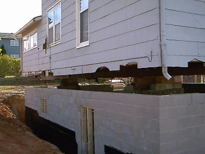 Eventually, the foundation was in place, the blocks were set, and the house finally began to nest on its former perch.  Don't forget that you can get a closer look by clicking on the photo and selecting a larger size image from the menu at the top of the page.