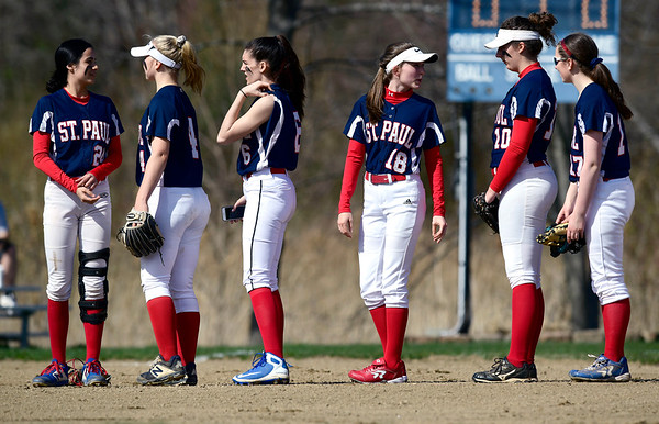 4/17/2019 Mike Orazzi | Staff Members of the St. Paul softball team at the start of Wednesday's game with Watertown in Bristol.