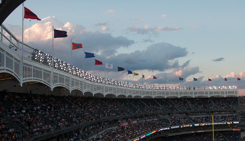 Team flags and lighting bank at dusk -- Yankee Stadium, the Bronx, NYC