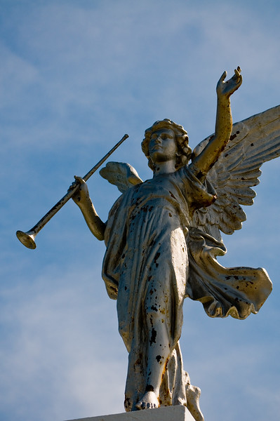 This angel stands atop the gate to a small cemetery