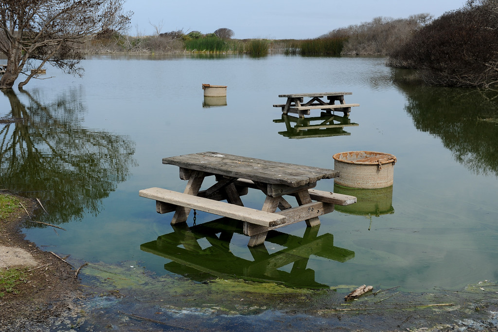 . Ventura County public works department began draining  the Santa Clara River estuary which has flooded the campground at McGrath State Beach Park in Oxnard now that they have received the final OK from regulators, Monday, July 22, 2013. (Michael Owen Baker/L.A. Daily News)