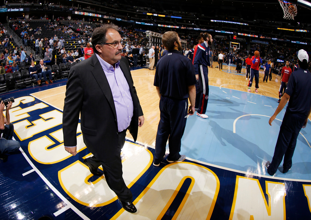 . As viewed through a fisheye lens, Detroit Pistons head coach Stan Van Gundy walks the baseline on his way to the bench to lead the Pistons in his first regular-season game as head coach against the Denver Nuggets in the first quarter of an NBA basketball game in Denver on Wednesday, Oct. 29, 2014. (AP Photo/David Zalubowski)