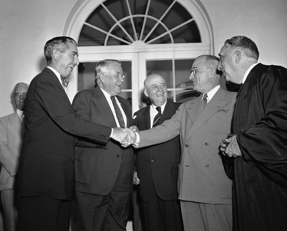 . A smiling Tom Clark receives the congratulations of President Harry S. Truman after taking the oath of office as an Associate Justice of the Supreme Court, Aug. 24, 1949.  Left to right: Clark, Vice President Alben W. Barkley, House Speaker Sam Rayburn, Pres. Truman and Chief Justice Fred M. Vinson, who administered the oath.  Clark resigned as attorney general to succeed the late Justice Frank Murphy on the high court. (AP Photo/Byron Rollins)