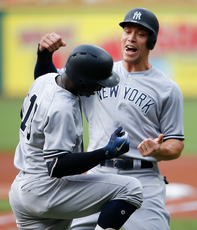 . New York Yankees\' Didi Gregorius, left, celebrates with Aaron Judge after hitting a three-run home run off Cleveland Indians starting pitcher Mike Clevinger during the first inning of a baseball game, Saturday, July 14, 2018, in Cleveland. (AP Photo/Ron Schwane)