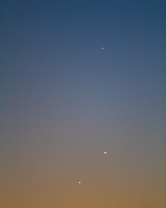 Planetary trio of Venus, Jupiter and Mercury. Jupiter and Venus in conjunction with Mercury above, May 28, 2013. A planetary trio is when three planets fit within a circle no greater than 5 degrees diameter.