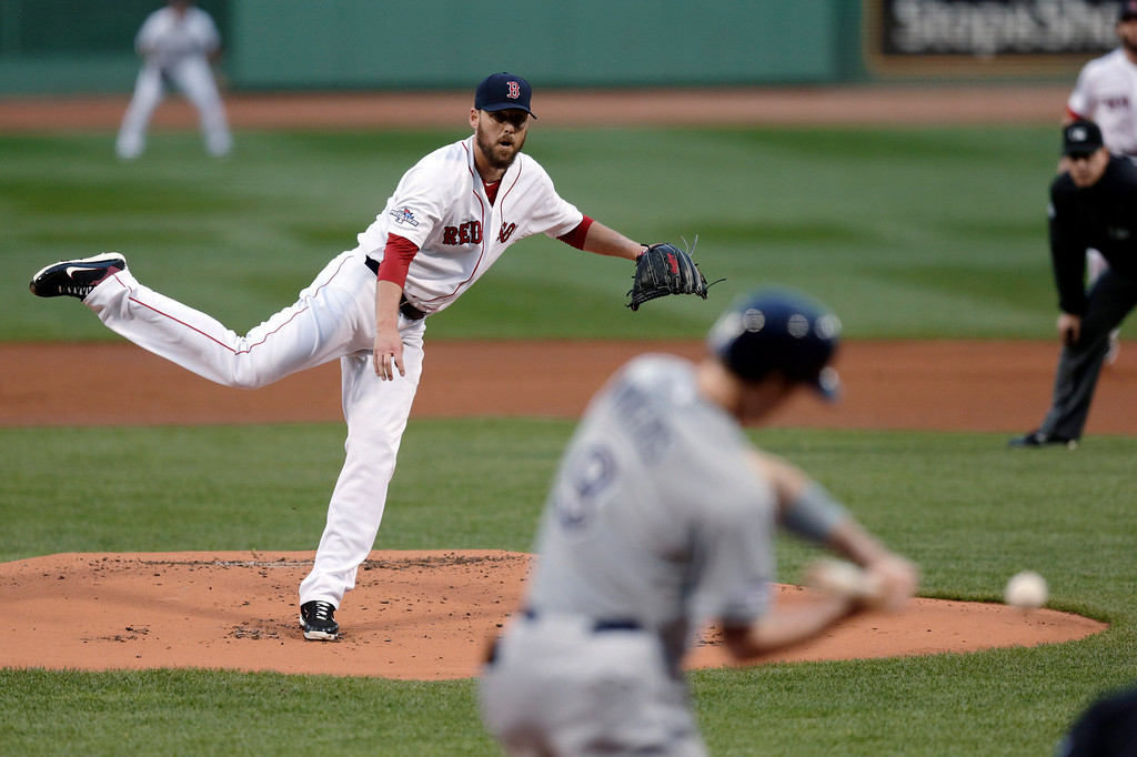 . Boston Red Sox starting pitcher John Lackey follows through on a pitch to Tampa Bay Rays\' Wil Myers in the first inning of Game 2 of baseball\'s American League division series, Saturday, Oct. 5, 2013, in Boston. (AP Photo/Charles Krupa)