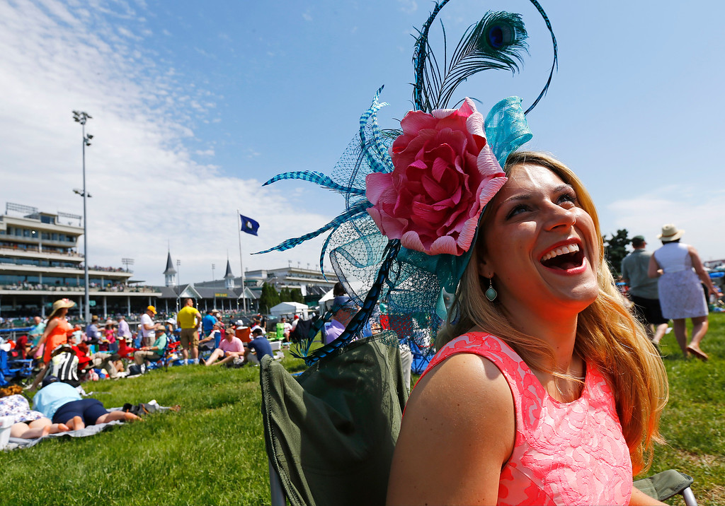 . Andrea Godlew wears a hat before the 142nd running of the Kentucky Derby horse race at Churchill Downs Saturday, May 7, 2016, in Louisville, Ky. (AP Photo/Julio Cortez)