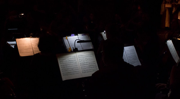 05/09/19 Wesley Bunnell | Staff Musicians are silhouetted against their sheet music during a rehearsal of Don Carlo by Giuseppe Verdi on Tuesday evening at Trinity-On-Main Arts Center. The opera will feature 4 performances with the first this Friday May 10th at 7:30 at Trinity-On-Main.