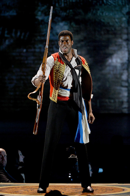 . Kyle Scatliffe performs onstage with the cast of \'Les Miserables\' during the 68th Annual Tony Awards at Radio City Music Hall on June 8, 2014 in New York City.  (Photo by Theo Wargo/Getty Images for Tony Awards Productions)