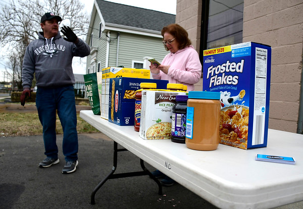 3/28/2020 Mike Orazzi | Staff Tom and Marie White at the food drive collection at the Hillside Community Church on Broad Street in Bristol on Saturday morning.