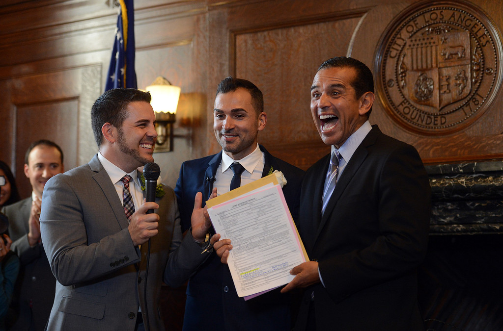 . Jeff Zarrillo, left,  and Paul Katami, Burbank, who successfully challenged Proposition 8 in Hollingsworth v. Perry, are married by Mayor Antonio Villaraigosa at City Hall June 28, 2013. The couple got a marriage license as soon as they heard the United States Court of Appeals for the Ninth Circuit lifted its stay of the Federal District Court decision that found California�s Proposition 8 unconstitutional. (Hans Gutknecht/Los Angeles Daily News)
