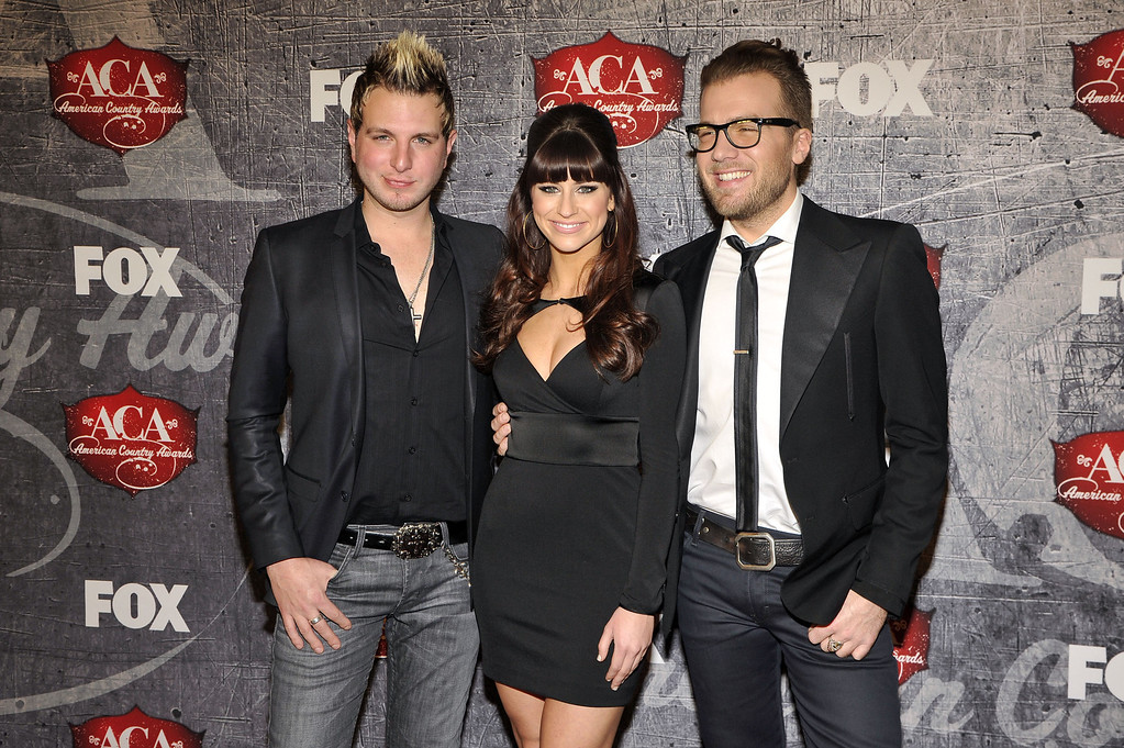 . From left, Mike Gossin, Rachel Reinert and Tom Gossin of Gloriana arrive at the American Country Awards on Monday, Dec. 10, 2012, in Las Vegas. (Photo by Jeff Bottari/Invision/AP)