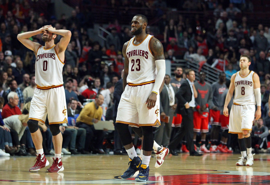 . Cleveland Cavaliers forward LeBron James (23), forward Kevin Love (0) and guard Matthew Dellavedova (8) walk off the court after a missed basket against the Chicago Bulls during the second half of an NBA basketball game in Chicago, on Saturday, April 9, 2016. (AP Photo/Jeff Haynes)