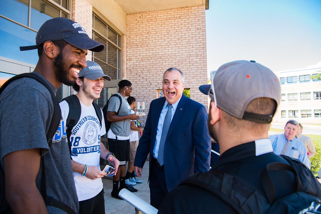 President Joe Bertolino with students laughing