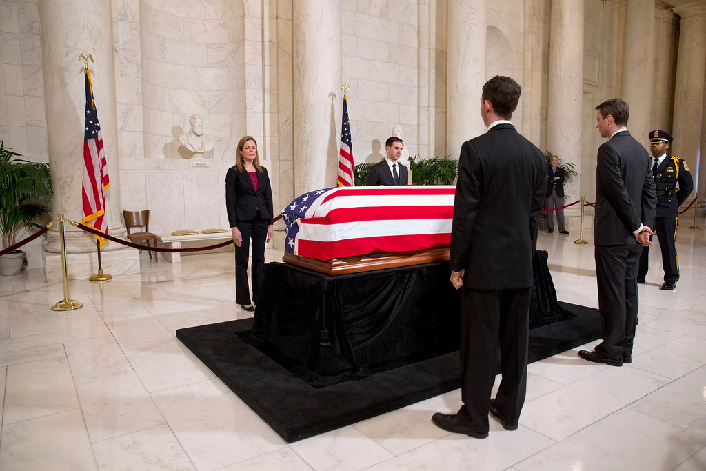 . Law clerks flank the casket of Supreme Court Justice Antonin Scalia during a private ceremony in the Great Hall of the Supreme Court in Washington, Friday, Feb. 19, 2016, where Scalia lies in repose. (AP Photo/Jacquelyn Martin, Pool)