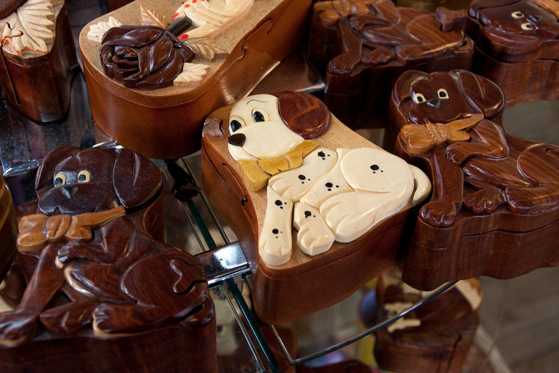 Nifty carved wood dog boxes.