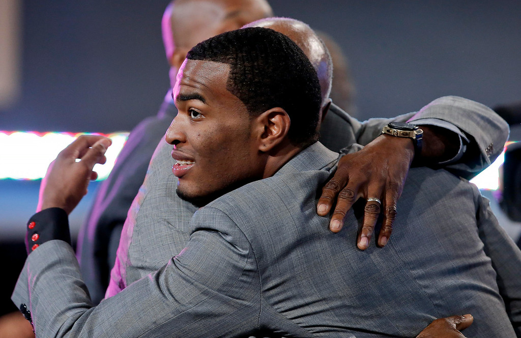. North Carolina State\'s T.J. Warren, right, is congratulated after being selected 14th overall by the Phoenix Suns during the 2014 NBA draft, Thursday, June 26, 2014, in New York.  (AP Photo/Kathy Willens)