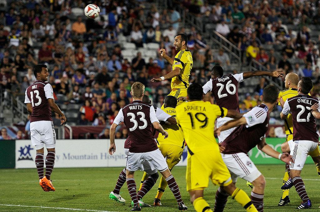 . Justin Meram #9 of the Columbus Crew goes up for a header off a corner kick during an MLS match against the Colorado Rapids at Dick\'s Sporting Goods Park on July 4, 2014, in Commerce City, Colorado. (Photo by Daniel Petty/The Denver Post)