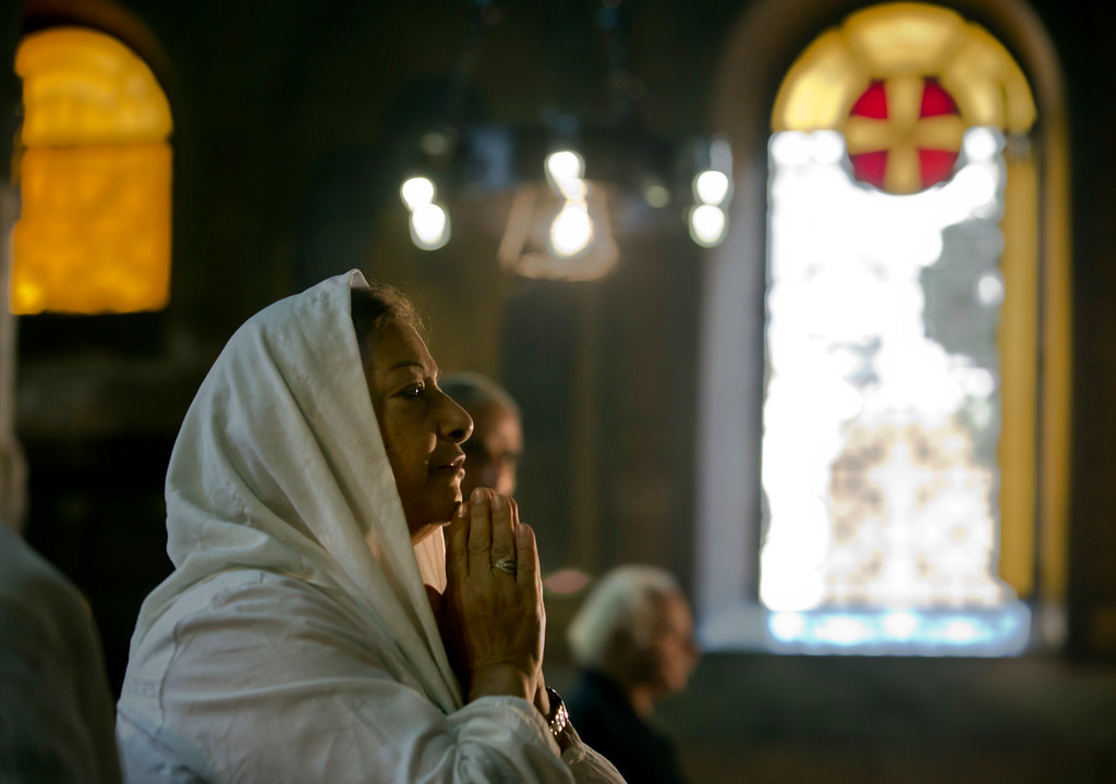 . An Egyptian Coptic Christian prays during a service for the departed remembering the victims of EgyptAir flight 804, at Al-Boutrossiya Church, the main Coptic Cathedral complex in Cairo, Egypt, Sunday, May 22, 2016. The Airbus A320 plane was flying from Paris to Cairo with 66 passengers and crew when it disappeared early last Thursday over the Mediterranean Sea. (AP Photo/Amr Nabil)