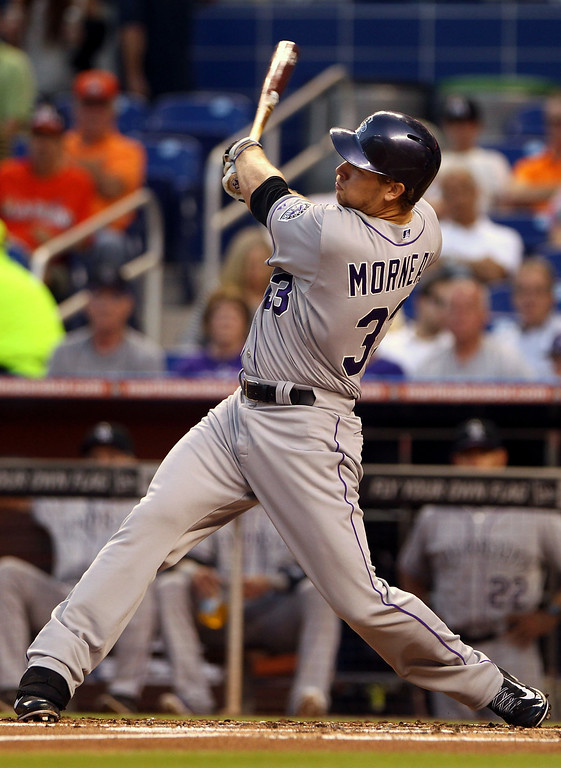 . MIAMI, FL - APRIL 01: Justin Morneau #33 of the Colorado Rockies gets a base hit against the Miami Marlins during the third inning at the Marlins Park on April 1, 2014 in Miami, Florida.  (Photo by Marc Serota/Getty Images)