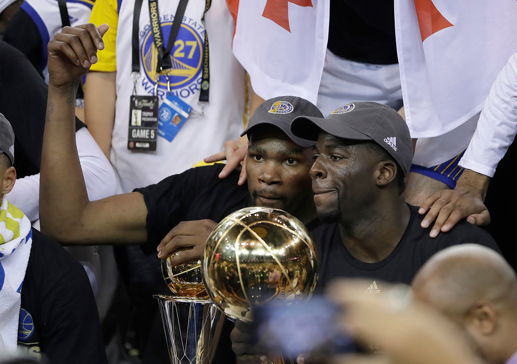 . Golden State Warriors forward Kevin Durant, left, and forward Draymond Green celebrate after Game 5 of basketball\'s NBA Finals against the Cleveland Cavaliers in Oakland, Calif., Monday, June 12, 2017. The Warriors won 129-120 to win the NBA championship. (AP Photo/Marcio Jose Sanchez)