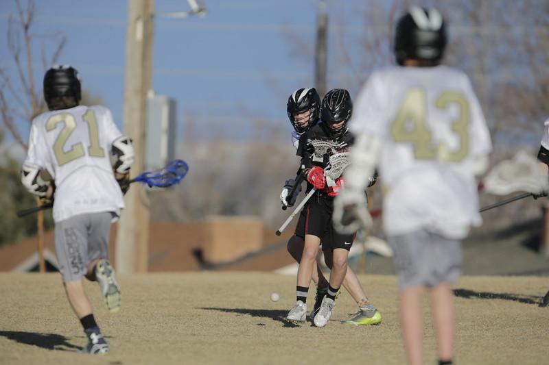 JPM0306-JPM0306-Jonathan first HS lacrosse game March 9th.jpg