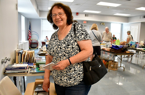 8/7/2019 Mike Orazzi | Staff Edith Valencis shops for items for sale during the Plainville Senior Center tag sale on Wednesday.