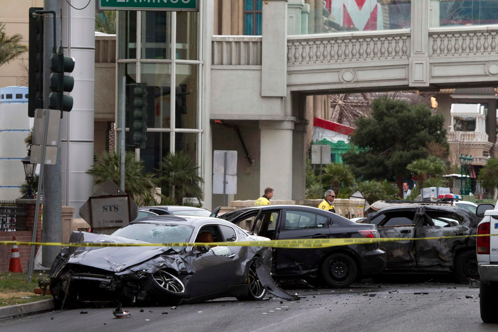 . Wrecked cars are seen on Las Vegas Boulevard and Flamingo Avenue as Las Vegas Metro Police investigate a shooting and multi-car accident that left three people dead and three injured on the Las Vegas Strip in Las Vegas, Nevada in the early morning February 21, 2013. REUTERS/Las Vegas Sun/Steve Marcus