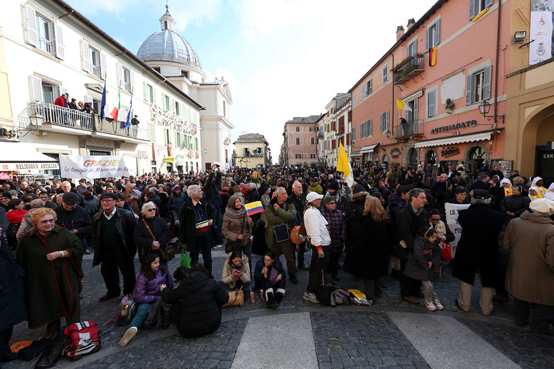 . Faithful gather in front of Pope\'s summer residence of Castel Gandolfo, the scenic town where Pope Benedict XVI will spend his first post-Vatican days and make his last public blessing as pope,Thursday, Feb. 28, 2013. (AP Photo/Luca Bruno)