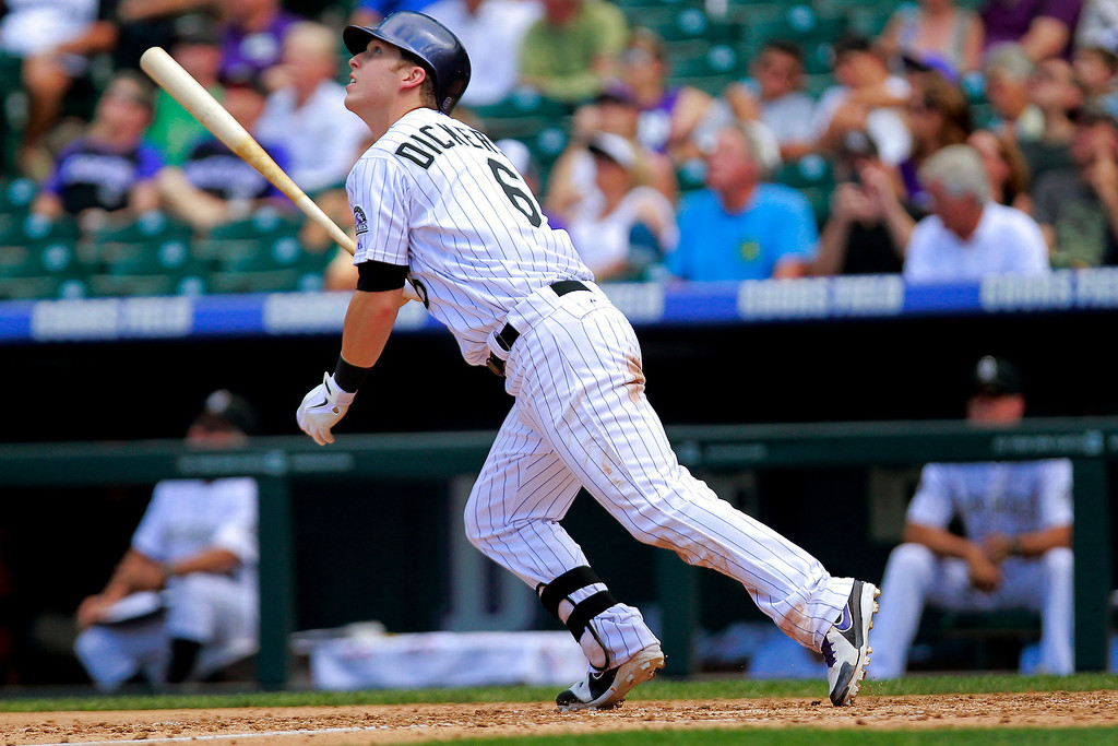 . Colorado Rockies\' Corey Dickerson watches his fly-out against the San Diego Padres during the fifth inning of a baseball game Wednesday, Aug. 14, 2013 in Denver. (AP Photo/Barry Gutierrez)