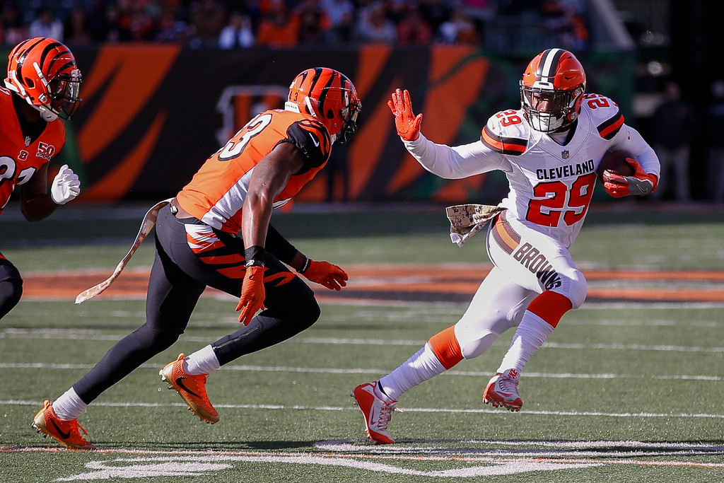 . Cleveland Browns running back Duke Johnson (29) runs the ball against Cincinnati Bengals free safety George Iloka (43) in the first half of an NFL football game, Sunday, Nov. 26, 2017, in Cincinnati. (AP Photo/Gary Landers)