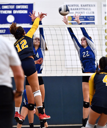 11/16/2019 Mike Orazzi | StaffrBristol Easterns Sage Scarritt (24) and Hannah Webber (22) Woodstock Academy's Paula Hernandez Aulet (12) during the 2019 State Girls Volleyball Tournament Class L Quarterfinals at BEHS in Bristol Saturday.