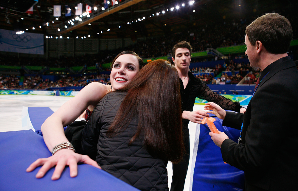 . Tessa Virtue and Scott Moir of Canada leave the ice after their performance in the Figure Skating Compulsory Ice Dance on day 8 of the Vancouver 2010 Winter Olympics at the Pacific Coliseum on February 19, 2010 in Vancouver, Canada.  (Photo by Cameron Spencer/Getty Images)