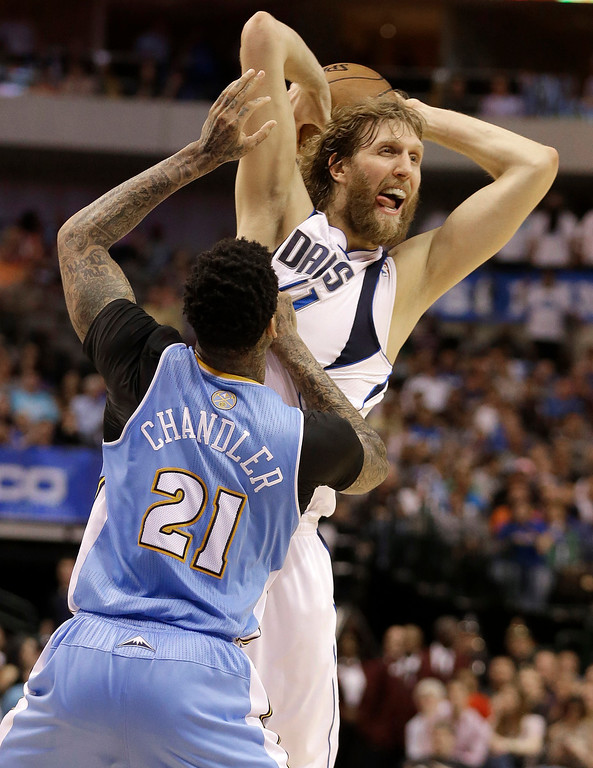 . Dallas Mavericks power forward Dirk Nowitzki, top, of Germany, looks to against Denver Nuggets shooting guard Wilson Chandler (21) during overtime play of an NBA basketball game on Friday, April 12, 2013, in Dallas. The Mavericks won 108-105. (AP Photo/LM Otero)