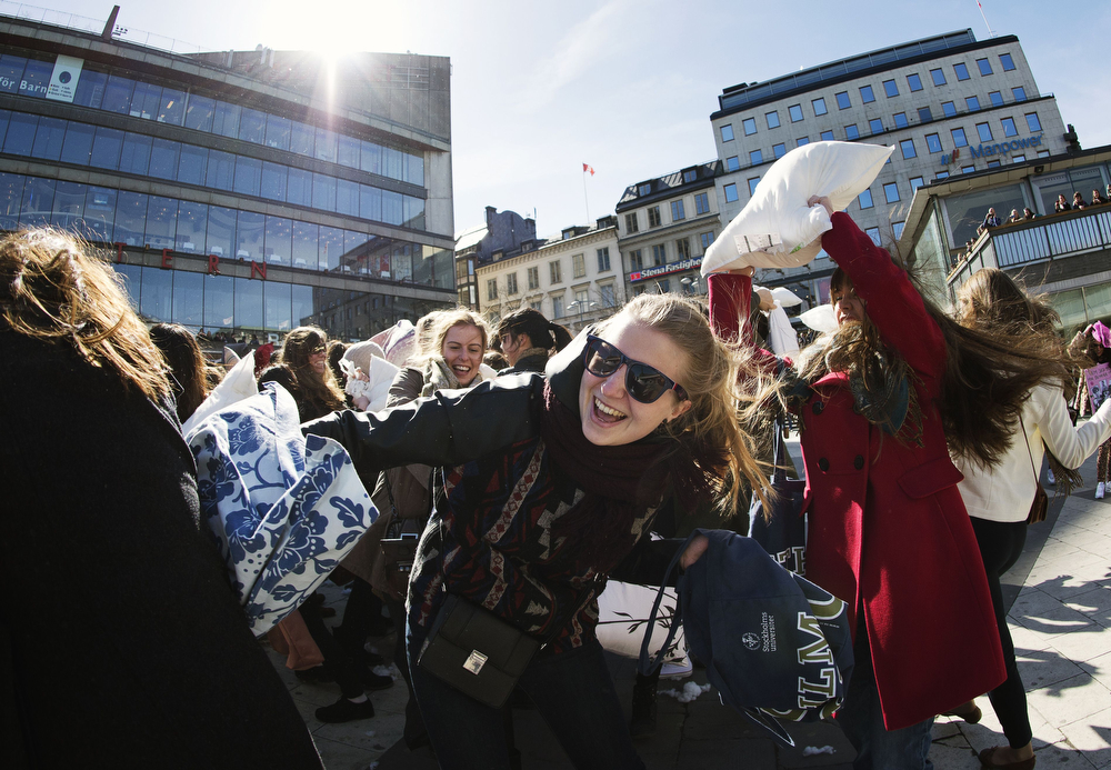 Description of . Young women take part in the International Pillow Fight Day on April 5, 2014 in Stockholm, Sweden. Pillow fights take place in various places around the world on April 5, 2014. (JONATHAN NACKSTRAND/AFP/Getty Images)