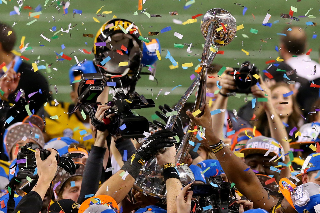. ARLINGTON, TX - JANUARY 03:  The Missouri Tigers celebrate after the Tigers 41-31 victory against the Oklahoma State Cowboys during the AT&T Cotton Bowl on January 3, 2014 in Arlington, Texas.  (Photo by Ronald Martinez/Getty Images)