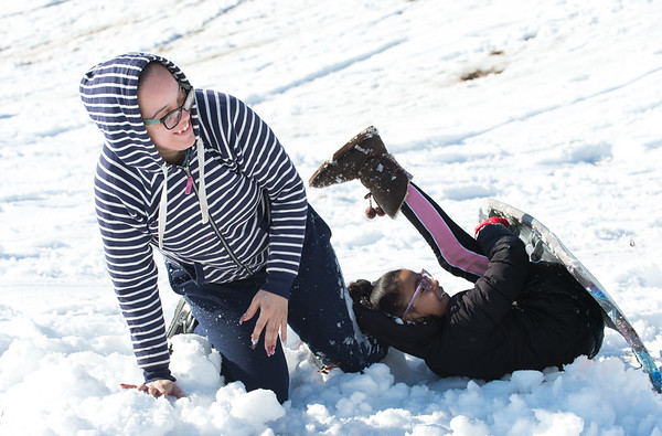 03/04/19 Wesley Bunnell | Staff Millie Semidey and Liliana Valentin, age 9, get up after both sliding off of their sled at Walnut Hill Park on Monday afternoon while out with family and friends.