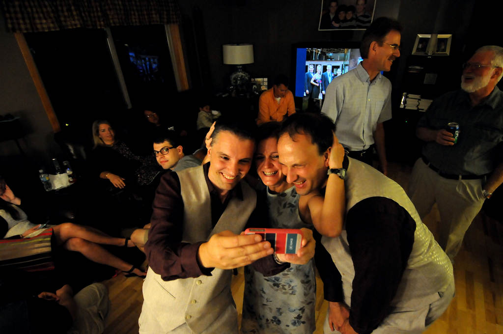 . Ryan Pfeifle, left,  and Bradley Weber, right, take a cell phone picture with friend Amy Feist around 11:30 pm before their wedding. (Pioneer Press: Sherri LaRose-Chiglo)