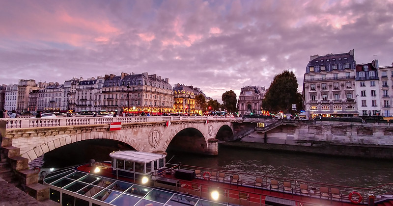 Pont Saint-Michel bridge on the Seine river in Paris at sunset.