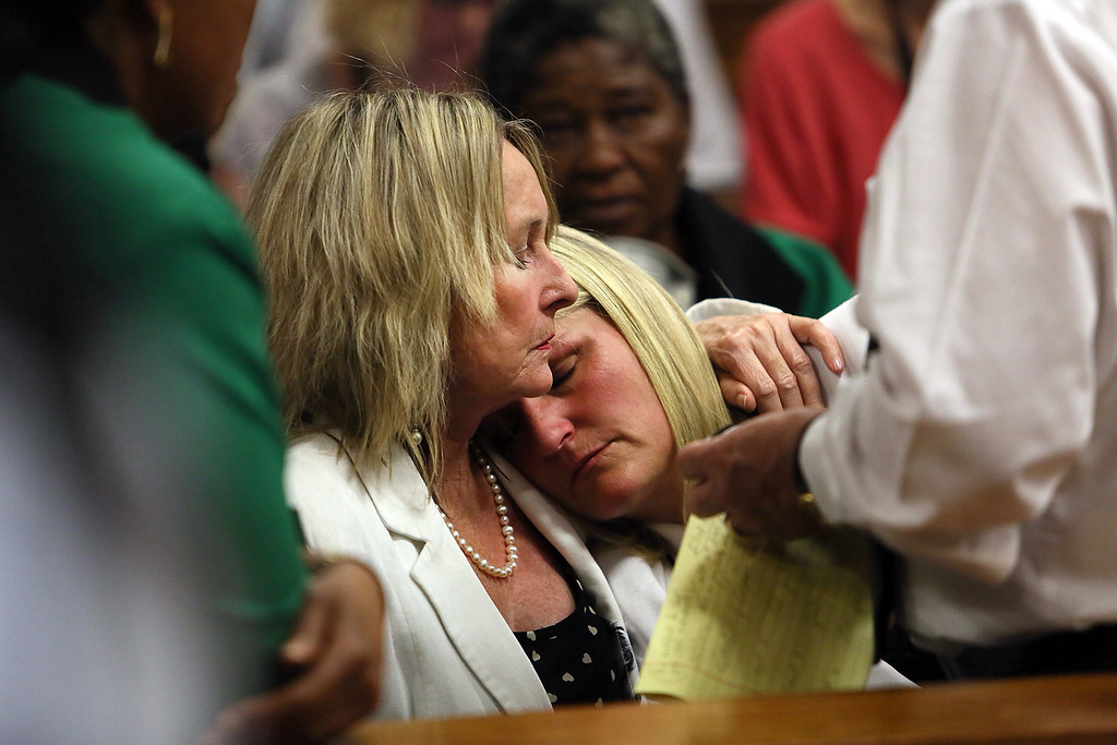 """. June Steenkamp (L), mother of Reeva Steenkamp, holds her cousin Kim Martin as judgment is handed down in the murder trial of South African Paralympic athlete Oscar Pistorius in the High Court in Pretoria on September 12, 2014, where Pistorius was found guilty of culpable homicide for killing his girlfriend Reeva Steenkamp. Pistorius was acquitted of a more serious charge of murder, but South African Judge Thokozile Masipa said that he had acted \""""negligently\"""" in killing the blonde law graduate, named as one of the world\'s 100 sexiest women.  Alon Skuy/AFP/Getty Images"""