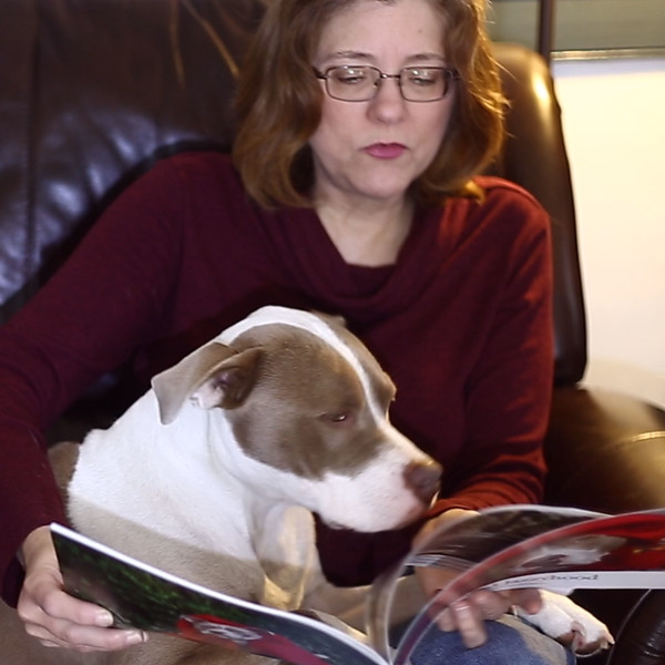 me reading to Jazzy.jpg