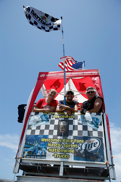 . DAYTONA BEACH, FL - JULY 06:  Fans pose for a photo while they tailgate during the NASCAR Sprint Cup Series Coke Zero 400 at Daytona International Speedway on July 6, 2013 in Daytona Beach, Florida.  (Photo by Scott Halleran/Getty Images)