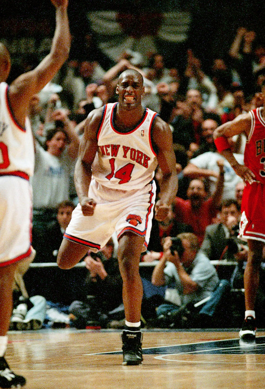 . FILE - In this May 8, 1994 file photo, New York Knicks Anthony Mason (14) celebrates as the Knicks pull within one point of the Chicago Bulls during the fourth period of the NBA Eastern Conference Semifinal game in New York.  The New York Knicks spokesman Jonathan Supranowitz confirmed Saturday, Feb. 28, 2015 that Mason, a rugged power forward who was a defensive force for several NBA teams in the 1990s, has died. He was 48. (AP Photo/Bill Kostroun)