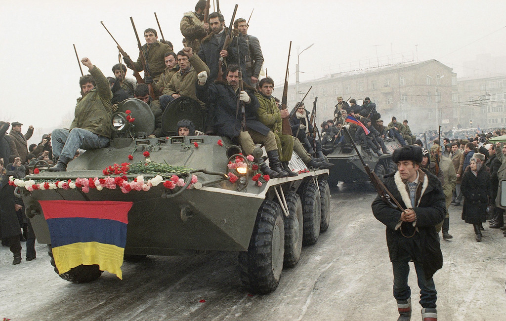 . Armenian civilians ride through their capital in Yerevan on Sunday, Jan. 22, 1990 to mourn Mofses Gorgisyan a prominent nationalist killed in a battle with Azerbaijanis. (AP Photo)