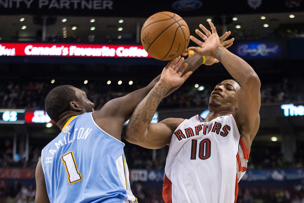 . Toronto Raptors\' DeMar DeRozan, right, is fouled by Denver Nuggets\' Jordan Hamilton during the second half of an NBA basketball game on Sunday, Dec. 1, 2013, in Toronto. (AP Photo/The Canadian Press, Chris Young)