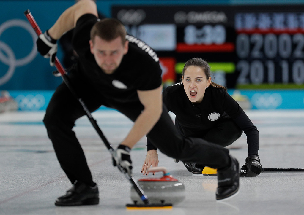 . Russian athletes Anastasia Bryzgalova, right, and Aleksandr Krushelnitckii play during their mixed doubles curling semi-final match against Switzerland at the 2018 Winter Olympics in Gangneung, South Korea, Monday, Feb. 12, 2018. Switzerland won. (AP Photo/Aaron Favila)